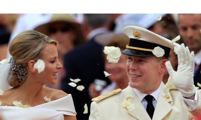 Prince Albert II of Monaco and Princess Charlene of Monaco depart from the Monaco palace after their religious wedding ceremony on July 2, 2011. Monaco's Princess Charlene has given birth to royal twins, Gabriella and Jacques, Wednesday, Dec. 10, 2014. (AP Photo/Jean Paul Pelissier)