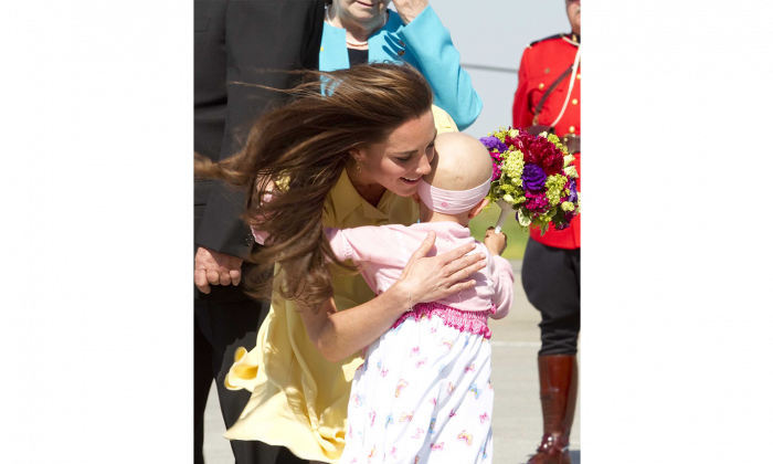In a hug that captured hearts around the world, the Duchess of Cambridge embraces six-year-old cancer patient Diamond Marshall as the royal couple arrives in Calgary on July 7, 2011. Diamond died on Dec. 8, 2014. (REUTERS/Ian Vogler/Pool)
