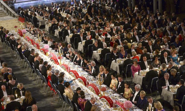 An overview of guests seated at the traditional Nobel banquet at the Stockholm City Hall, Wednesday, Dec. 10, 2014, following the Nobel Prize award ceremonies for Medicine, Physics, Chemistry, Literature and Economic Sciences. (AP Photo/TT News Agency, Fredrik Sandberg)