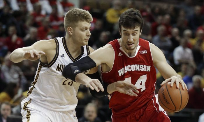 Wisconsin's Frank Kaminsky drives past Wisconsin-Milwaukee's J.J. Panoske during the first half of an NCAA college basketball game Wednesday, Dec. 10, 2014, in Milwaukee. (AP Photo/Morry Gash)