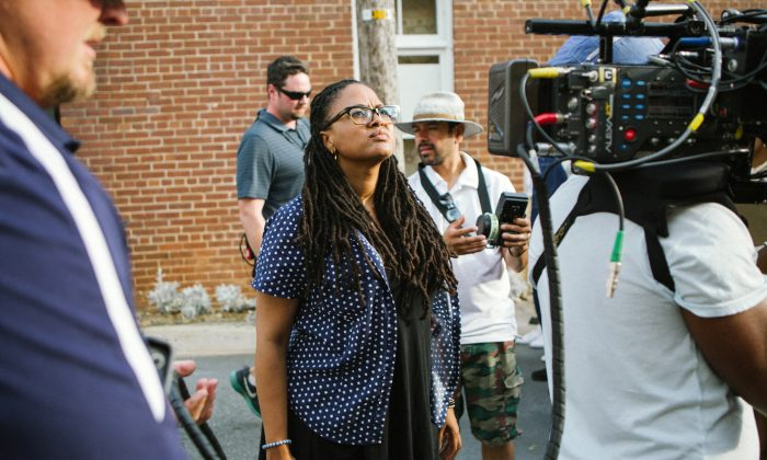 "In this image released by Paramount Pictures, director Ava DuVernay  appears on the set during the filming of ""Selma."" DuVernay was nominated for a Golden Globe for best director for the film on Thursday, Dec. 11, 2014. The 72nd annual Golden Globe awards will air on NBC on Sunday, Jan. 11. (AP Photo/Paramount Pictures, Atsushi Nishijima)"