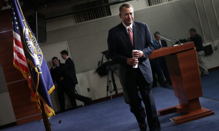 Speaker of the House John Boehner (R-Ohio) leaves after a press conference at the Capitol in Washington, D.C., on Dec. 11, 2014. Boehner has worked aggressively pass the omnibus bill. (Win McNamee/Getty Images)