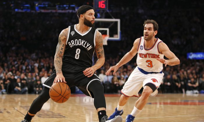 New York Knicks guard Jose Calderon (3) defends as Brooklyn Nets guard Deron Williams (8) drives in the first half of an NBA basketball game at Madison Square Garden in New York, Tuesday, Dec. 2, 2014. (AP Photo/Kathy Willens)