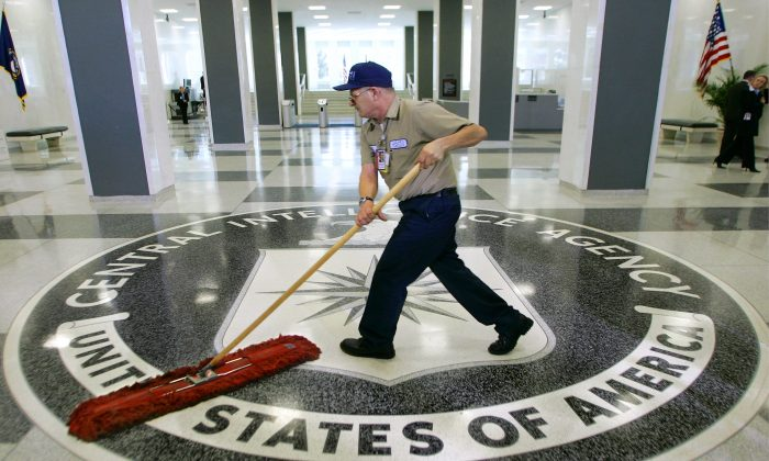 In this March 3, 2005 file photo, a workman literally cleans house at the Central Intelligence Agency headquarters in Langley, Va. (AP Photo/J. Scott Applewhite)