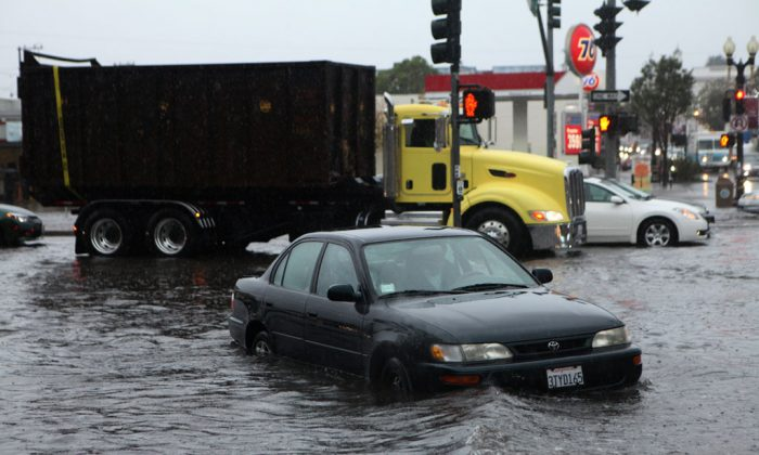 Mark Kunze of San Bruno stalls his car in the flooded intersection of Airport Blvd. and Grand Ave., in South San Francisco, on Thursday, Dec. 11, 2014. Several vehicles stalled in and around the intersection after driving through the deep water. A powerful storm churned through the San Francisco Bay Area on Thursday, knocking out power to tens of thousands and delaying commuters while bringing a soaking of much needed rain. (AP Photo/Alex Washburn)