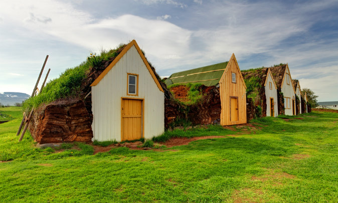 Old traditional Icelandic farm with mossy roofs via Shutterstock*
