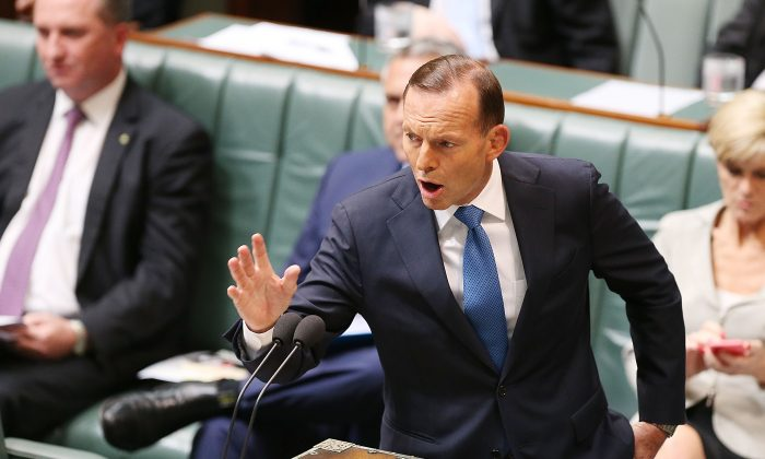Prime Minister Tony Abbott during House of Representatives question time at Parliament House, on Dec. 4 in Canberra, on the official last day of sitting at Parliament for 2014. Parliament will return on Feb. 9, 2015. (Stefan Postles/Getty Images)