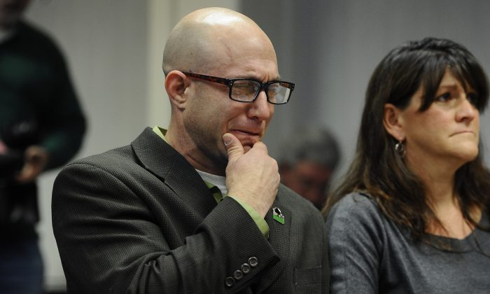 Jeremy Richman (L) weeps as he watches a video of his daughter, Sandy Hook Elementary school shooting victim Avielle Richman in Newtown, Conn., on Friday, Nov. 14, 2014. Days ahead of the Sandy Hook Elementary School shooting anniversary, advocates and lawmakers in New York on Dec. 11, 2014 called for stricter gun laws. (AP Photo/Jessica Hill)