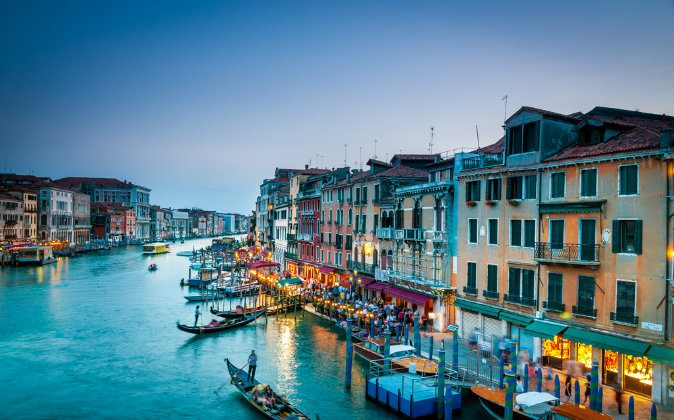 Colorful view of Grand canal in Venice at the twilight via Shutterstock*