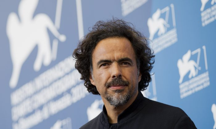 """""""Birdman"""" director Alejandro Inarritu poses during a photo at the 71st edition of the Venice Film Festival in Venice, Italy. (AP Photo/Andrew Medichini)"""