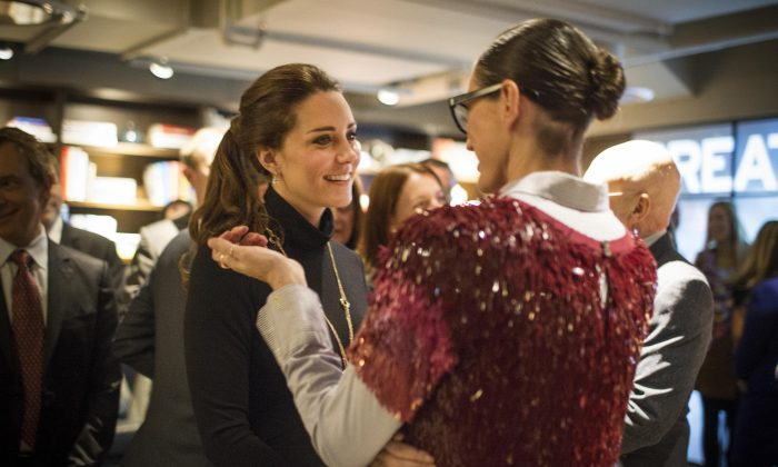 Kate, Duchess of Cambridge, speaks to Jenna Lyons at the Creativity is GREAT at NeueHouse on Tuesday, Dec. 9, 2014 in New York. Prince William and Kate are on the last of their 3-day tour of New York City, their first visit to the United States since a trip to California in 2011. (AP Photo/ Christopher Wahl, Pool)