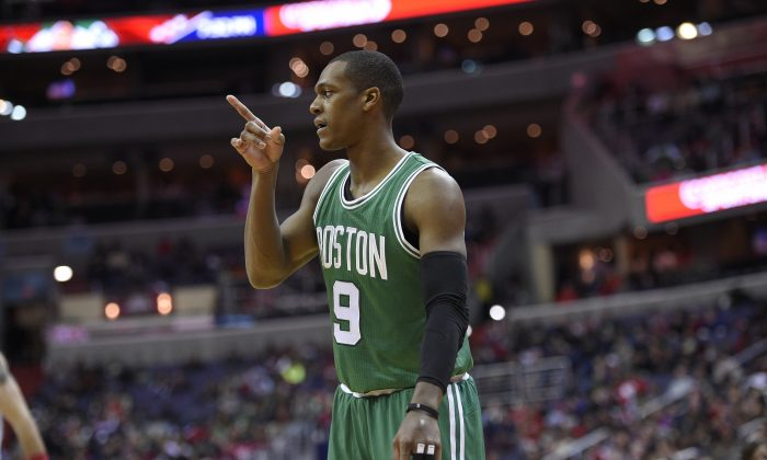 Boston Celtics guard Rajon Rondo (9) gestures during the first half of an NBA basketball game against the Washington Wizards, Monday, Dec. 8, 2014, in Washington. (AP Photo/Nick Wass)