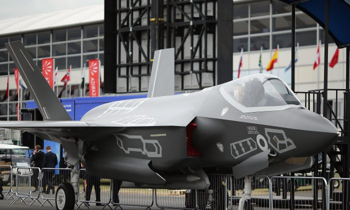 A model of a Lockhead Martin F-35 on display during an airshow on July 16 in Farnborough, England. A Chinese national is being charged in the United States for allegedly stealing and trying to transfer new F-35 designs to China. (Dan Kitwood/Getty Images)