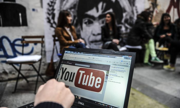 A person uses a laptop computer showing Youtube's logo on March 27, 2014 in Istanbul. (Ozan Kose/AFP/Getty Images)