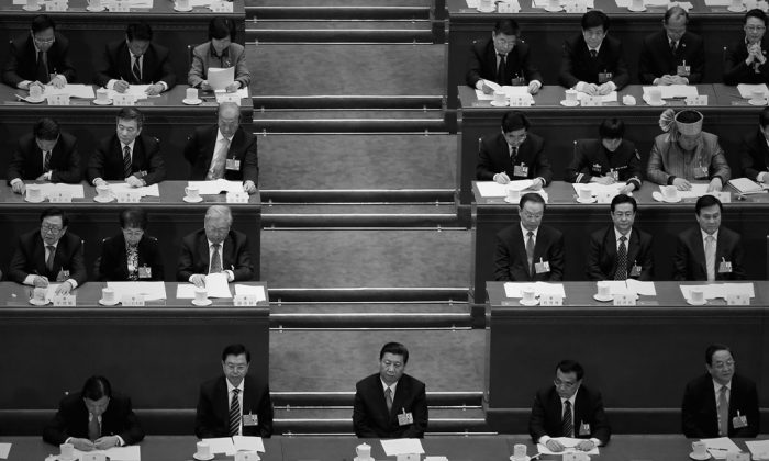 Chinese Communist Party General Secretary Xi Jinping (C), with Chairman of the Standing Committee of the National People's Congress Zhang Dejiang (2nd L), Premier Li Keqiang (2nd R) and incoming-Chairman of Chinese People's Political Consultative Conference Yu Zhengsheng (R) at a political meeting in Beijing in March 2013. Cyber attacks were launched against the Epoch Times Chinese website recently, during the purge of Party official Zhou Yongkang. (Feng Li/Getty Images)