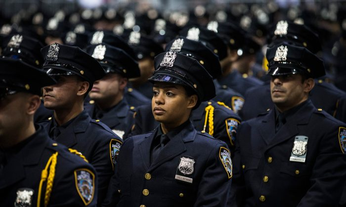 New York City Police Academy cadets attend their graduation ceremony at the Barclays Center in Brooklyn, New York, on July 2, 2013.  (Andrew Burton/Getty Images)