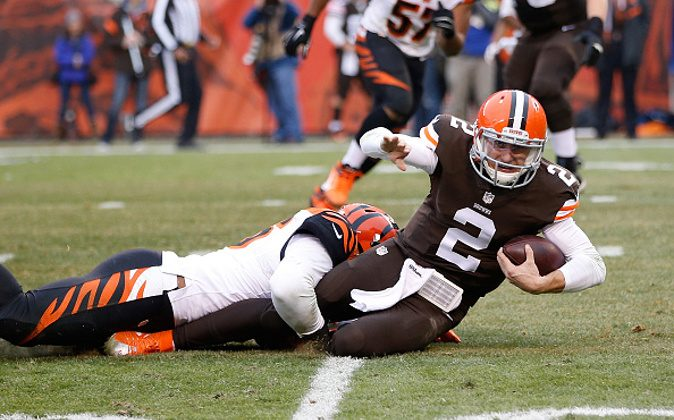 CLEVELAND, OH - DECEMBER 14: Johnny Manziel #2 of the Cleveland Browns gets tackled by Chris Carter #56 of the Cincinnati Bengals during the second quarter at FirstEnergy Stadium on December 14, 2014 in Cleveland, Ohio. (Photo by Joe Robbins/Getty Images)