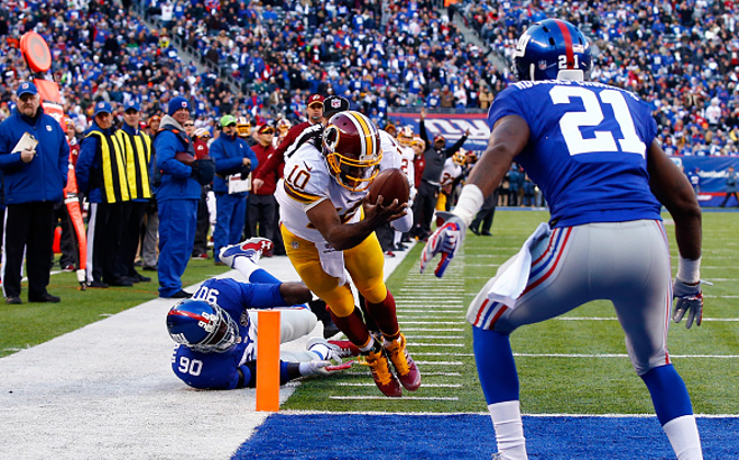 EAST RUTHERFORD, NJ - DECEMBER 14: Robert Griffin III #10 of the Washington Redskins fumbles the ball out of bounds in End Zone in the second quarter against the New York Giants during their game at MetLife Stadium on December 14, 2014 in East Rutherford, New Jersey. (Photo by Al Bello/Getty Images)