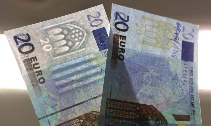 The difference between a real (left) and a fake (right) 20 Euro note, at a counterfeit money analysis lab in Mainz, Germany. On Dec. 12, 2014, Italian police discovered a 556,000-euro shipment of counterfeit coins minted in China. (Hannelore Foerster/Getty Images)
