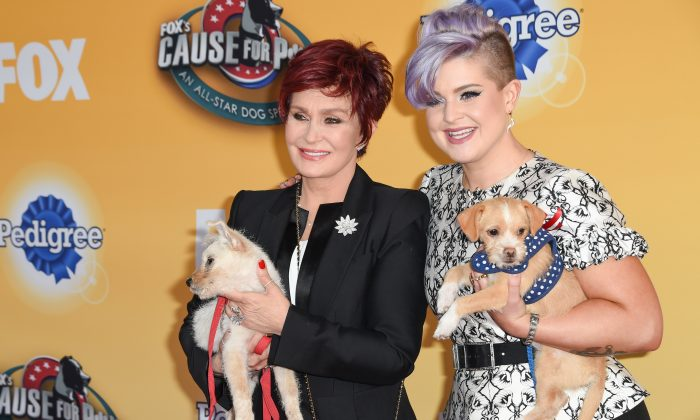 Sharon Osbourne, left and Kelly Osbourne seen at 'Cause For Paws: An All-Star Dog Spectacular at Barker Hangar on Saturday, November 22nd, 2014, in Santa Monica, CA. (Photo by Rob Latour/Invision/AP)