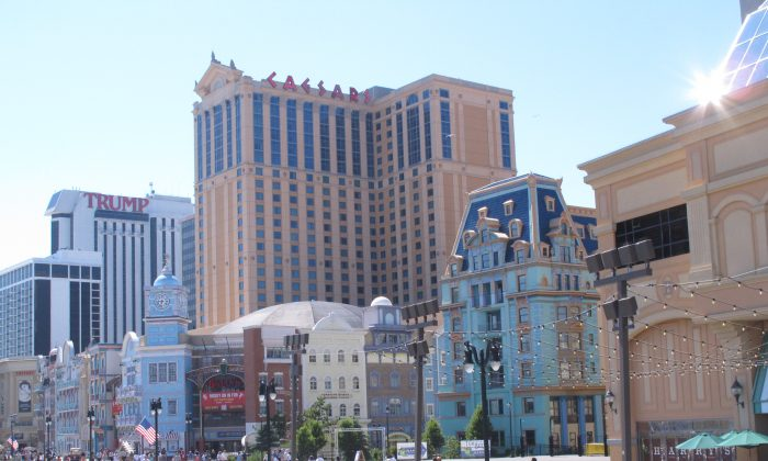 Resorts Casino Hotel, the Trump Taj Mahal Casino Resort, and Revel Casino Hotel in Atlantic City, N.J., on June 16, 2014. Atlantic City's Golden Nugget casino dropped a threat on Monday to file a lawsuit blocking a package of tax relief for Atlantic City's eight casinos. (AP Photo/Wayne Parry)