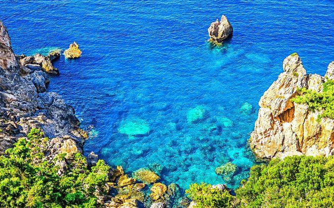 Cliffside coastline on Greek island Corfu via Shutterstock*