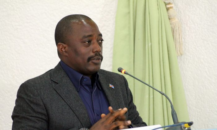Congolese President Joseph Kabila addresses some 250 people gathered at a hotel in the north eastern city of Beni, on October 31, 2014. (Alain Wandimoyi/AFP/Getty Images)