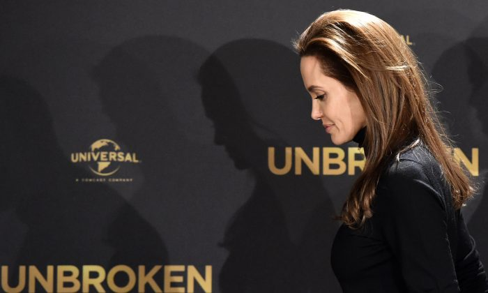 US actress and director Angelina Jolie leaves after a photocall for her film 'Unbroken' on November 27, 2014 in Berlin. (AFP/Getty Images)