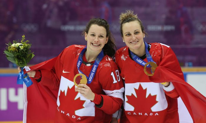 Gold medalists Catherine Ward (L) and Marie-Philip Poulin celebrate their incredible gold medal victory over the U.S. on Feb. 20, 2014 in Sochi, Russia. (Bruce Bennett/Getty Images)