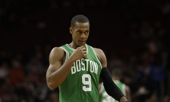 Boston Celtics' Rajon Rondo in action during an NBA basketball game against the Philadelphia 76ers, Monday, Dec. 15, 2014, in Philadelphia. (AP Photo/Matt Slocum)