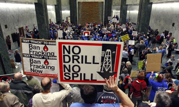 people take part in a rally against hydraulic fracturing of natural gas wells at the Legislative Office Building in Albany, N.Y. (AP Photo/Mike Groll, File)