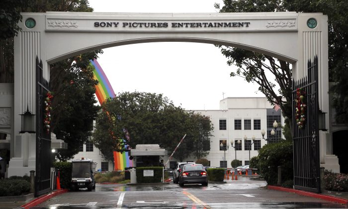 "Cars enter Sony Pictures Entertainment headquarters in Culver City, Calif., on Dec. 2, 2014. Hackers calling themselves Guardians of Peace on Tuesday, Dec. 16, 2014 released another round of data leaks, including ominous threats against the premiere of Sony Pictures' film ""The Interview,"" in which the group references the terrorist attacks of Sept. 11, 2001. (AP Photo/Nick Ut)"