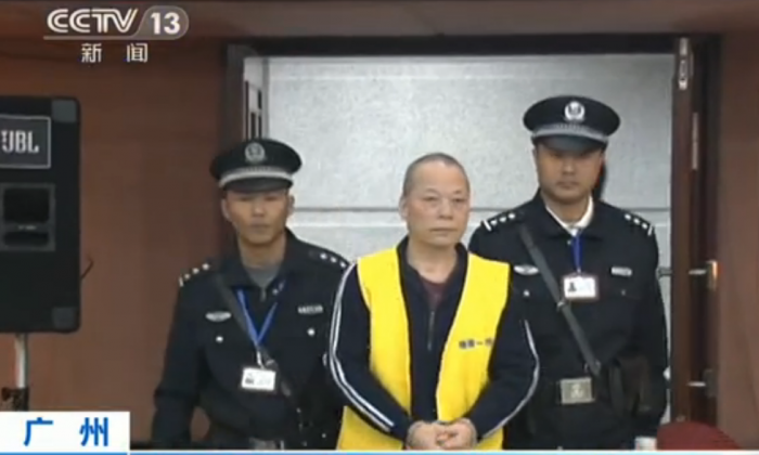 Chinese official Zhang Xinhua, former general manager of a state-owned company, is brought into court in Guangzhou of Guangdong Province, on Dec. 10, 2014. Zhang was sentenced to death for stealing tens of millions of dollars from the state. (Screenshot/CCTV)