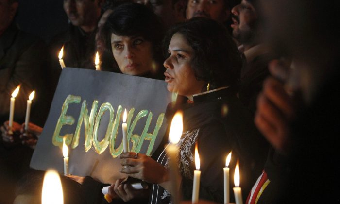 Pakistani civil society members take part in a candle light vigil for the victims of a school attacked by the Taliban in Peshawar, Tuesday, Dec. 16, 2014 in Islamabad, Pakistan. (AP Photo/Anjum Naveed)