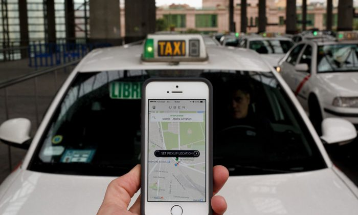 The smart phone taxi app 'Uber' shows how to select a pick up location at Atocha Station on Oct. 14, 2014, in Madrid, Spain. (Pablo Blazquez Dominguez/Getty Images)