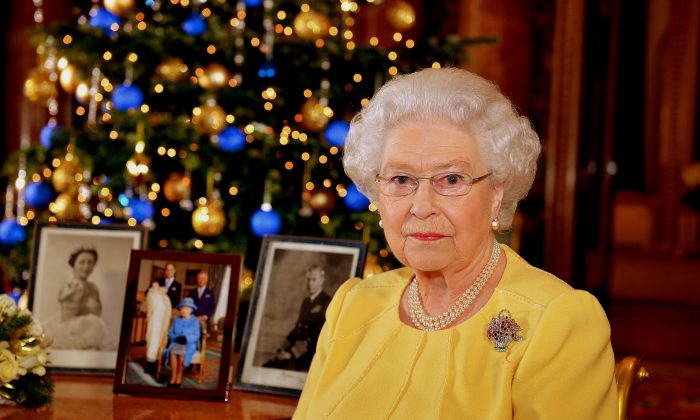 Queen Elizabeth II records her Christmas message to the Commonwealth, in the Blue Drawing Room at Buckingham Palace on December 12, 2013 in London England. (Photo by John Stillwell - WPA Pool/Getty Images)