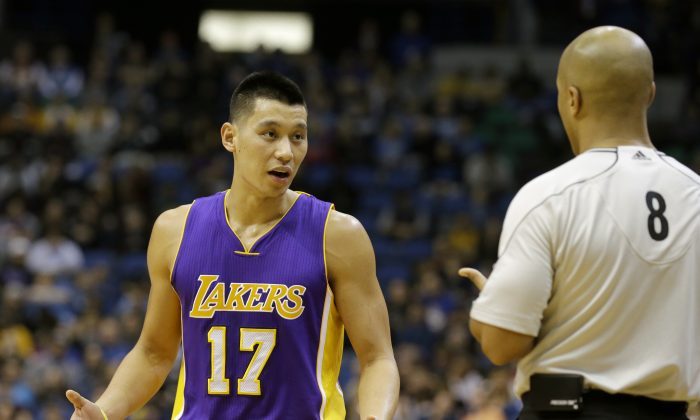 Los Angeles Lakers guard Jeremy Lin (17) talks with referee Marc Davis (8) during the fourth quarter of an NBA basketball game in Minneapolis, Sunday, Dec. 14, 2014. The Lakers won 100-94. (AP Photo/Ann Heisenfelt)