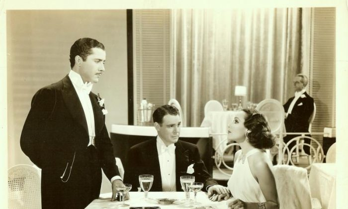 Dolores del Rio with Don Alvarado and Everett Marshall (sitting) I Live for Love, 1935. Dolores del Rio wears an Orry-Kelly gown. (Wikimedia Commons)