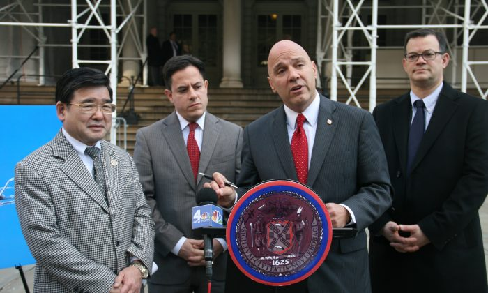 Council member Paul Vallone speaks at a press conference on the steps of City Hall, Manhattan, N.Y., on Dec. 17, 2014. Members proposed two bills to ban and regulate private drones. (Shannon Liao/Epoch Times)