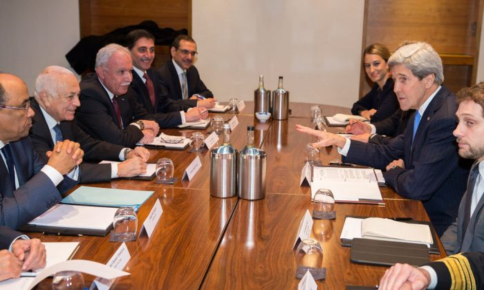 US Secretary of State John Kerry (2L) meets with Arab League secretary general Nabil El-Arabi (2L) on Tuesday, Dec. 16, 2014, in London. The meeting was to discuss the ongoing peace process between the Israelis and Palestinians. (AP Photo/Evan Vucci)