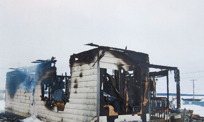 A burned-out house in St. Theresa Point First Nation, Manitoba, January 2011. A former band constable who rescued a toddler from a burning home on the reserve says he's haunted by a baby he wasn't able to save who perished in the fire. (The Canadian Press/HO, RCMP via Manitoba Law Courts)