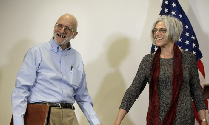 Alan Gross, released after five years in a Cuban prison, smiles as he and his wife Judy arrive for a news conference in Washington on Dec. 17, 2014. The White House is thankful to Canada for hosting secret meetings that led to the re-establishment of relations between the U.S. and Cuba. (AP Photo/Pablo Martinez Monsivais)