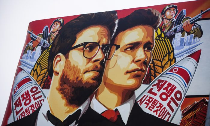 """A banner for """"The Interview""""is posted outside Arclight Cinemas, Wednesday, Dec. 17, 2014, in the Hollywood section of Los Angeles. A U.S. official says North Korea perpetrated the unprecedented act of cyberwarfare against Sony Pictures that exposed tens of thousands of sensitive documents and escalated to threats of terrorist attacks that ultimately drove the studio to cancel all release plans for """"The Interview."""" (AP Photo/Damian Dovarganes)"""