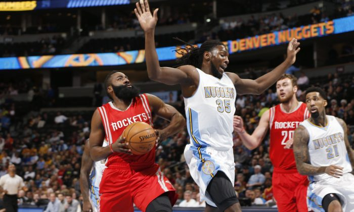 From left, Houston Rockets guard James Harden drives for a shot past Denver Nuggets forward Kenneth Faried as Rockets forward Donatas Motiejunas, of Lithuania, and Nuggets forward Wilson Chandler watch during the first quarter of an NBA basketball game on Wednesday, Dec. 17, 2014, in Denver. (AP Photo/David Zalubowski)