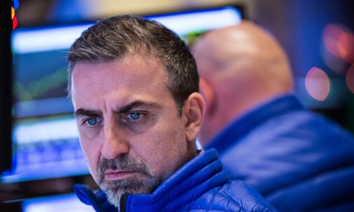 A trader works on the floor of the New York Stock Exchange during the afternoon of Dec. 17, 2014, in New York City. (Andrew Burton/Getty Images)