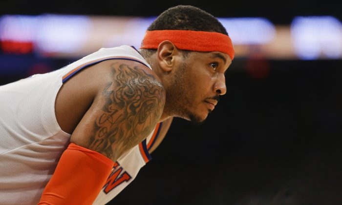 New York Knicks' Carmelo Anthony reacts during the second half of an NBA basketball game against the Dallas Mavericks, Tuesday, Dec. 16, 2014, in New York. The Mavericks won 107-87. (AP Photo/Frank Franklin II)