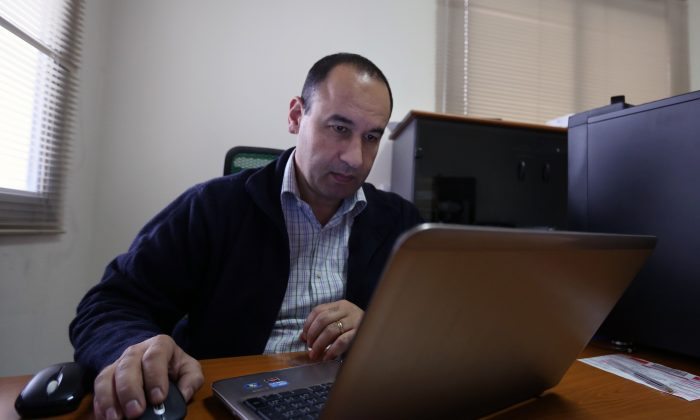 Lebanese Bahaa Nasr of Cyber Arabs checks his email from his office in Beirut, Lebanon, on Dec. 17, 2014. Cyber Arabs is an online safety project run by the London-based Institute for War and Peace Reporting and Nasr is among those who recently helped uncover a botched cyberattack suspected of having been carried out by the Islamic State group. (AP Photo/Bilal Hussein)
