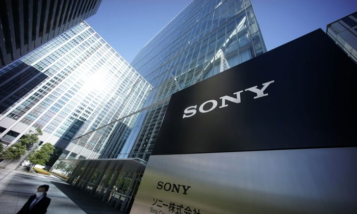 "A man walks out from the headquarters of Sony Corp. in Tokyo, Thursday, Dec. 18, 2014. A U.S. official says North Korea has been linked to the unprecedented act of cyberwarfare against Sony Pictures that exposed tens of thousands of sensitive documents and escalated to threats of terrorist attacks that ultimately drove the studio to cancel all release plans for the film at the heart of the hack, ""The Interview."" (AP Photo/Eugene Hoshiko)"