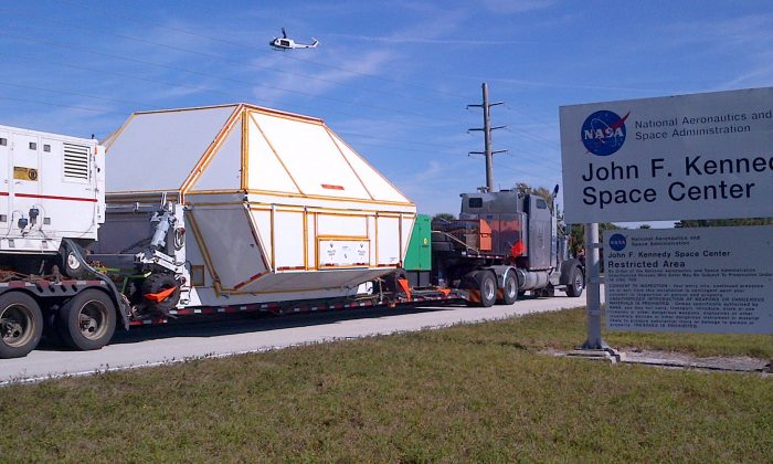The Orion spacecraft, in a protective covering, is returned to the agency's Kennedy Space Center in Cape Canaveral, Fla., on Dec. 18, 2014. It rocketed into orbit Dec. 5, traveling 3,600 miles into space on an unmanned test flight that proved to be a great success. NASA plans to use future models to help get astronauts to Mars in coming decades. (AP Photo/NASA)