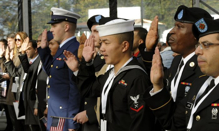 Soldiers from the different branches of military are sworn in during a naturalization ceremony at a ceremony on Liberty Island on Oct. 28, 2011. (Timothy A. Clary/AFP/Getty Images)
